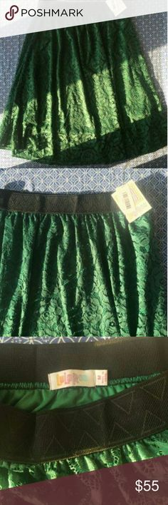 Lularoe Lola M Brand new with tags Lola skirt by Lularoe. Green with silky underskirt and lace overlay. Beautiful! Tag says 93% nylon, 7% elastane. Lining: 100% polyester. Machine wash cold, hang dry. LuLaRoe Skirts Midi