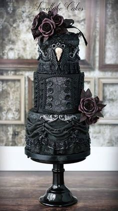 Black gothic wedding cake with raven skull cameo