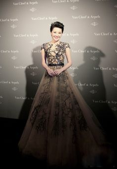 Xu Qing Van in  Zuhair Murad Couture at the Van Cleef & Arpels Beijing Dinner, 16 December 2013. It's got a tree on it!