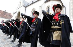 Soldiers in traditional uniforms participate in a changing of the guard ceremony in St. Mark's Square in Zagreb in 2010. The traditional dre...