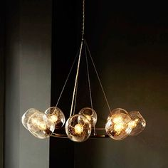 Eclipse Chandelier - Halo | west elm  Wondering if that extra cord looks strange