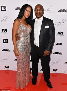 Shimmering: Mike was joined by his lovely wifeKiki Tyson who dazzled in a shiny silver number