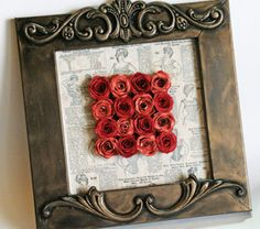daisy bucket paper and cardstock to make the roses, background using an old sears catalog and the perfect frame!