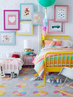 COLOR! Kids room from OH JOY! Love the artwork and beds