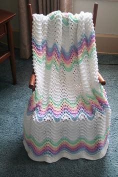 Blanket uses Partial 5 oz. skeins for the colors and 3 skeins of the white. Since the yarn has now been discontinued, Caron's Simply Soft or any worsted weight yarn can be used instead.
