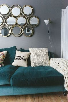 New home essentials handpicked by What Olivia Did Cream slogan printed cushion on a teal velvet sofa in Liv Purvis' new home. Teal Living Rooms, New Living Room, Living Room Sofa, Living Room Designs, New Home Essentials, Teal Sofa, Teal Velvet Sofa, Teal Bed, House Beds