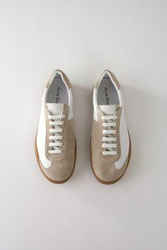 quality design 6007a a865b Acne Studios Lars Leather white are soft, minimal sneakers inspired by  vintage indoor sport shoes with Acne Studios branded tongues and monograms.