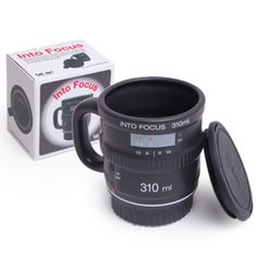 Camera Lens Coffee Mug Keeps your life in focusSometimes you need a hot drink to get back into focus, but when your thoughts wonder, your drink gets cold. Not anymore! Just put the cap back on your mug and your ideas and your drink stay fresh. This great novelty ceramic mug is from fiftytwo ways and features a cool camera lens design and comes with silicone lid for added convenience.FeaturesNovelty mugGreat camera lens designCeramic buildSilicone lid to keep your drink warmHeat resistant…