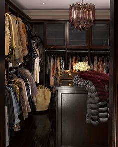 Kim Kardashian's closet - I love the dark wood and set up of everything.