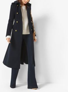 A full-length silhouette lends glamorous impact to this crisp military-inspired peacoat. A sleek lining provides added comfort, while gold-tone buttons offer punctuated polish.