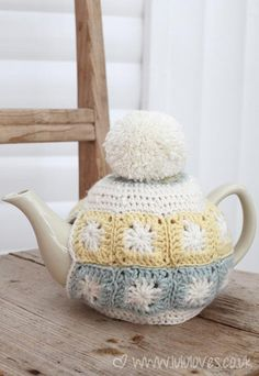 "No pattern but I thought this ""Granny Square Tea Cosy"" was cute...love the Pom-Pom!"