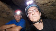 Director Frank Christopher and Jon Cradit rest after climbing down into a cave inside the Edwards Aquifer in San Marcos, Texas