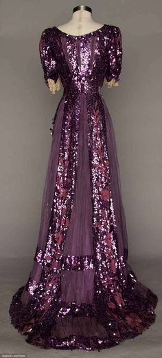 PURPLE PAILLETTE GOWN, c. 1905 Irregularly shaped paillettes embroidered floral motif on chiffon; lace cuffs; modified bust, chiffon