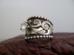 I LOVE THIS RING! Who is Travis Stringer and why can't he give me a western wedding ring like this... I want! *homerslobber*