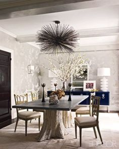 tree stump table and urchin chandelier