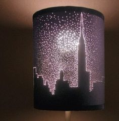 DIY picture shade: take an old lamp shade and poke holes in it. awesome way to redesign an old shade!