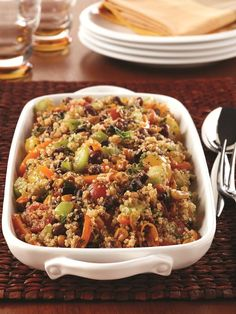 This Southwest Quinoa Salad contains a summery vegetable blend with THREE types of fresh tomatoes, bell peppers, and a zesty lime dressing. It uses one special shortcut ingredient, too! Naturally dairy-free, gluten-free and vegan recipe at GoDairyFree.org