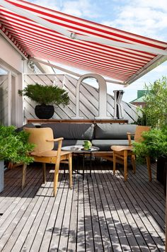 Candy striped awning over outdoor entertaining area Credit: Home by aleksi hautamäki, via Behance