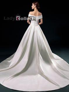 white off-shoulder wedding dress and evening