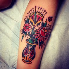 Love the flowers. Traditional tattoo. Flowers. Three Kings Tattoo Parlor
