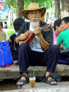 Ho Chi Minh City, Vietnam This man is a local original, I have seen him several times, riding his small bicycle or playing his guitar at the park. I like him, he radiates self sufficient peace.