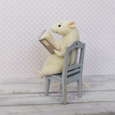 Hey, I found this really awesome Etsy listing at https://www.etsy.com/listing/236363780/felted-mouse-mouse-with-book-needle