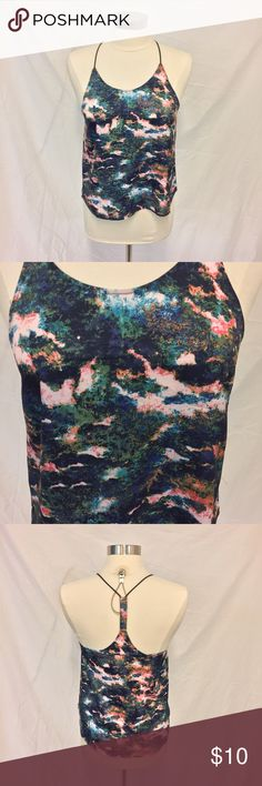 H&M watercolor tank top Another beautiful versatile top. Wear it alone with a mini and a vegan leather jacket over it for a night out, or use it as a layering piece under a super comfy cardigan and some knee high boots with black jeans or leggings! H&M Tops