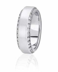 Diamonds Are Channel Set On The Beveled Angel Of This Unique Wedding Band With Cross Satin Finish