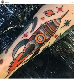 Traditional retro rocket / spaceship tattoo by Gre Hale, Rain City Manchester