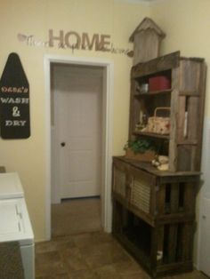 Laundry hutch made from pallets.. Laundry basket fits underneath with storage cabinets for crafting supplies.. Neat Love!