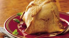 Pick pastry to serve to your guests.  Wrapped around tart apples and a cranberry sauce, pastry dumplings are a dessert everyone loves.