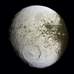 Iapetus as seen by the Cassini probe | 11th largest natural satellite in solar system - 3rd largest orbiting Saturn equatorial ridge - contrasting regions light and dark.