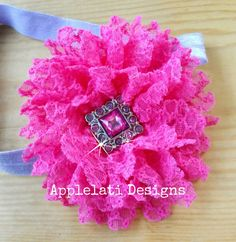 Girls lace flower hair clip with headband.     Girls Hot Pink Lace Print Flower With Headband / Photo Prop Flower / Baby Toddler Teen Headband This flower is attached to a lined alligator clip and measures approximately 4 in wide.     The flower clips on to the headband and can be worn by itself, in the hair, or with the headband.    applelati designs