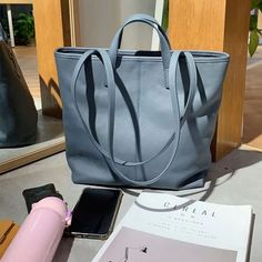 """Material: CowhideColor: Blue, Tan, WhiteDimensions: Height 11.8"""" x Width 11.4""""~13.8"""" x Depth 3.9"""" Inches Leather Bag, Leather Totes, Leather Handbags, Tote Handbags, Tote Bags, Work Tote, Shopper Bag, Black Tote Bag, Purses And Bags"""