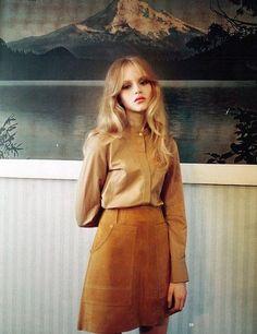 rust mini skirt / camel shirt / soft hair
