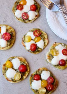 Grilled Pesto Pizzettes This one speaks for it self. Made with a lot of love, really easy and really, but I mean really tasty. These Pizzettes are made with Bocconcini, that's why they are so perfect.