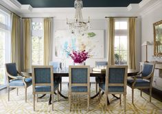 White moldings provide a crisp juxtaposition to a dramatic navy painted ceiling in the dining room. - Elegant Homes ®/ Photo: Werner Straube / Design: Christine Hughes