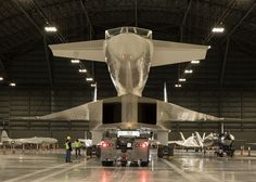 Restoration staff move the North American XB-70 Valkyrie into the new fourth…