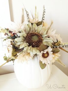white craft pumpkin and white/gold/light warm colors faux flora to transition from Halloween to Autumn decor.