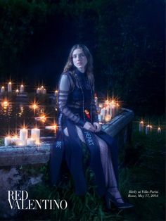 Surrounded by candle light, Birdy stars in Red Valentino's fall 2016 advertising campaign