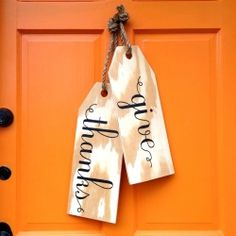 These oversized wood tags are a perfect wreath alternative for your front door! DIY by That's My Letter