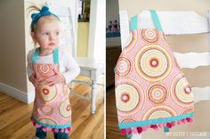 Make an apron out of a reusable shopping bag.  Genius!  Easy wipe surface, handles become the neck piece, and you just add some ribbon to tie it around back.