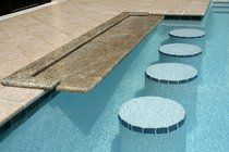 Granite pool bar with built in swim-up stools