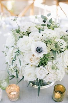 Textured, neutral centerpieces, cream roses, anemones, olive branches, eucalyptus. Floral Occasions | The Villa Wedding | Brandon Kidd Photography