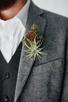 air plant boutonniere - photo by Monika Gauthier Photography http://ruffledblog.com/earthy-industrial-bohemian-wedding-inspiration