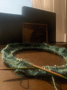 One of my favorite knitting projects -- a soft lace cowl, stitched from alpaca yarn.