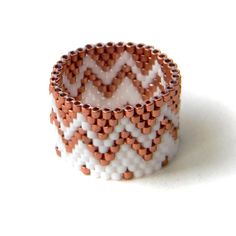 White and Copper Beaded ring - beadwork jewelry - peyote ring - beadwoven ring by Anabel27shop on Etsy https://www.etsy.com/listing/241981760/white-and-copper-beaded-ring-beadwork