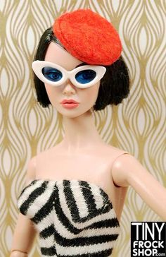 This Barbie 1959-61 striped swim suit in black and white is classic. The two we have are repros in great condition