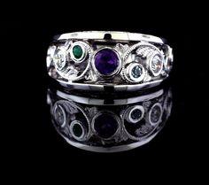 Hand made custom fabricated mothers ring with amethyst, aquamarine, diamonds and emerald. Created using original wedding bands and diamonds