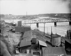 Chippewa Falls Riverfront. Part of this railroad bridge is still standing today. Exact year unknown. Between 1889- 1916 according to collection. Courtesy of the Wisconsin Historical Society.
